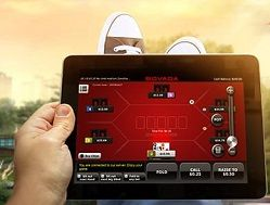Man Playing Bodog Mobile on his tablet